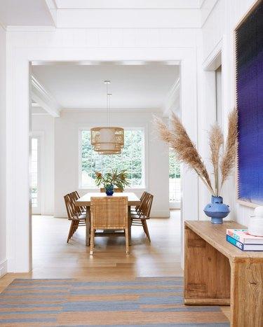 scandinavian hallway with blue and beige rug