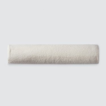 cream bolster pillow