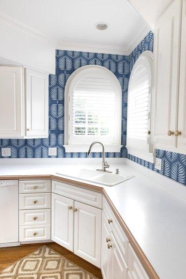 white kitchen with blue boho botanical wallpaper splash back