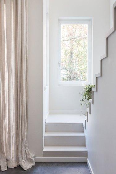 scandinavian hallway with neutral drapes