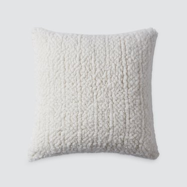 textured handwoven cream pillow