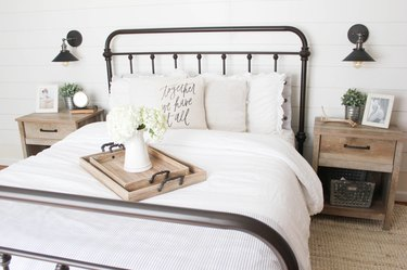cone shaped black wall lights in white farmhouse bedroom