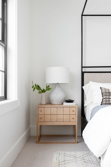 organic cement table lamp on wooden bedside table