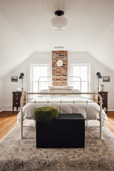 farmhouse bedroom with semi-flush mounted light and black wall lighting