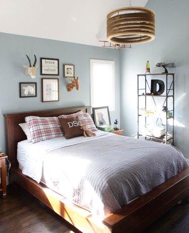 teen bedroom with statement wooden ceiling light