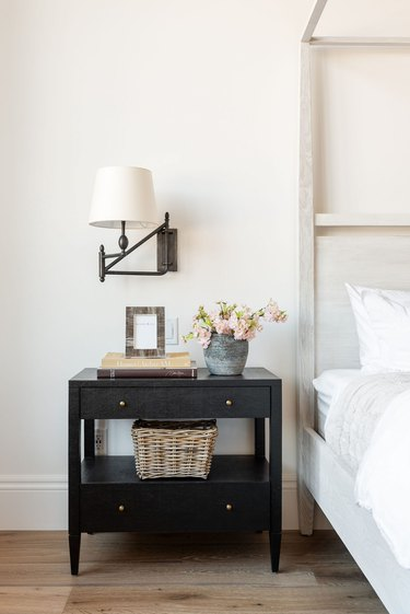 neutral bedroom with modern farmhouse wall lighting