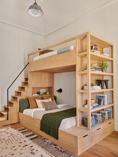 wooden bunk beds with small farmhouse light
