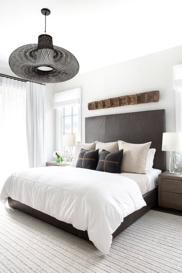 large wire ceiling light in modern farmhouse bedroom