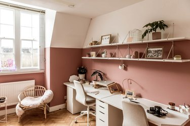 pink home office with white furniture near window