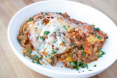 plate of raviolo lasagna with impossible meat bolognese