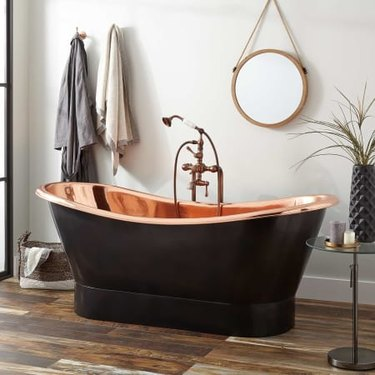 Freestanding copper bathroom faucet and tub