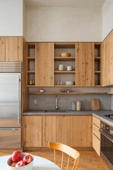 Countertops with Oak Cabinets in modern rustic oak kitchen with concrete countertops