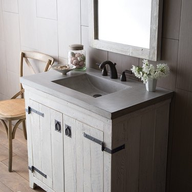 powder room with vanity with concrete integrated sink and countertop