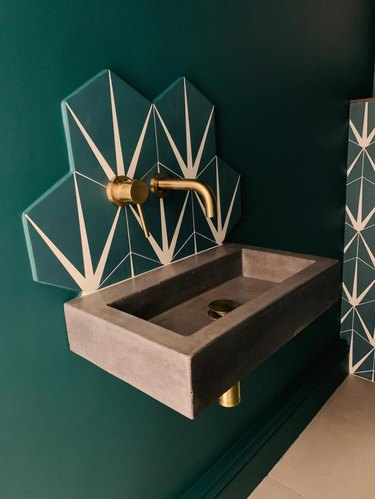 wall-mounted integrated sink in a green bathroom