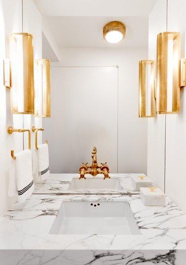 Copper bathroom faucet in glam bathroom