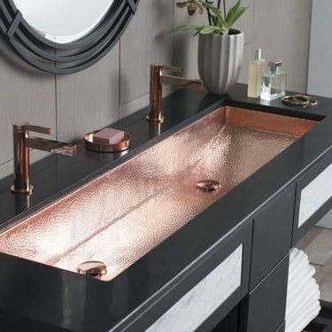 Double bathroom sink with copper bathroom faucets