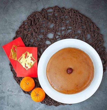 Oh My Food Recipes Nian Gao next to tangerines and red envelopes