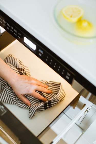 Wipe out microwave after cleaning with lemon