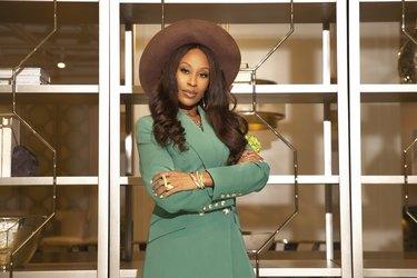 designer keia mcswain in front of bookshelf