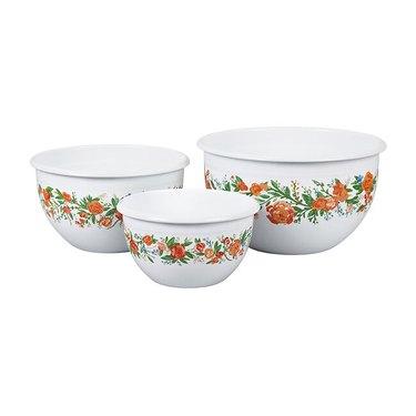 three white boals with orange floral design