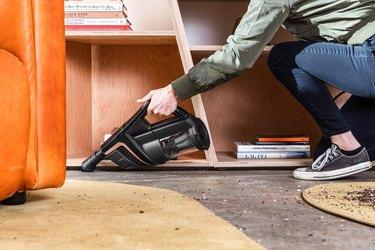 woman vacuuming mess