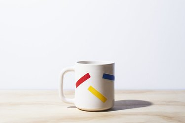 white mug with colorful pattern