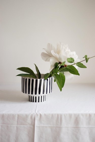 black and white striped bowl with white flower