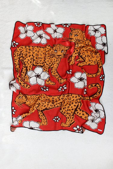 red blanket with leopards and flowers