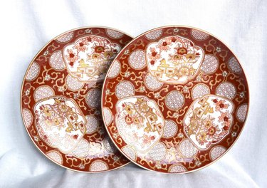 two red and gold imari plates