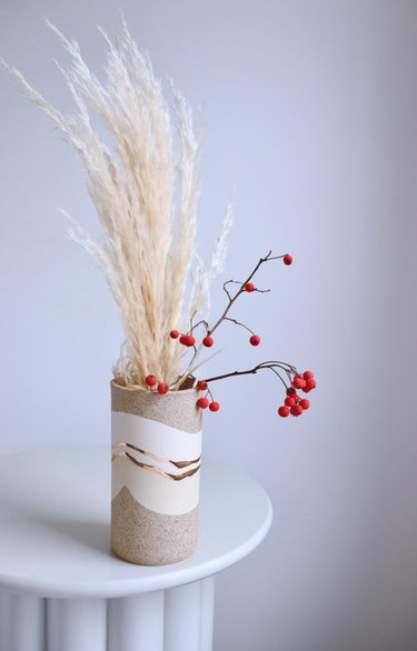 ceramic vase with grass and berries