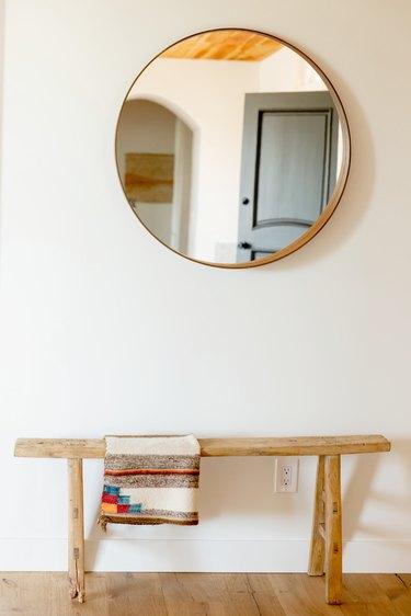 minimalist hallway round mirror