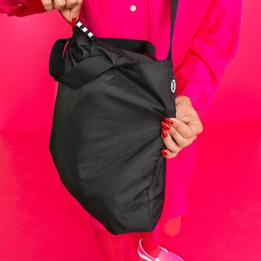 person holding black bag