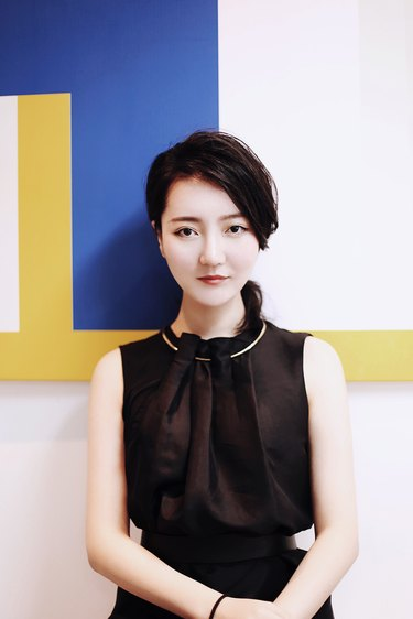 designer and architect li xiang in front of colorblocked wall