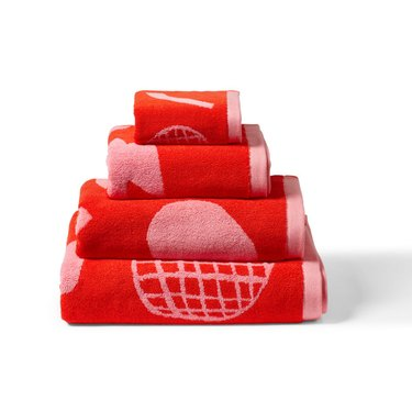pink and red towels in a stack with astract shapes