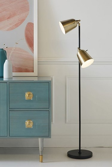 brushed brass metal Bedroom Floor Lamps next to blue bedroom drawers