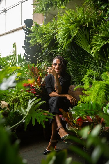 person sitting amidst plants