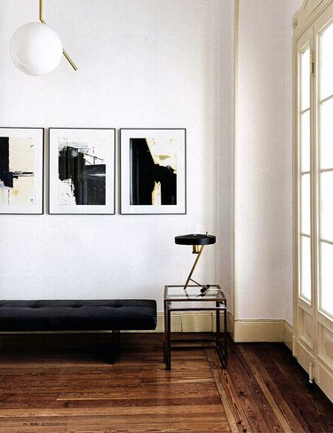 minimalist hallway entryway with black and gold accents