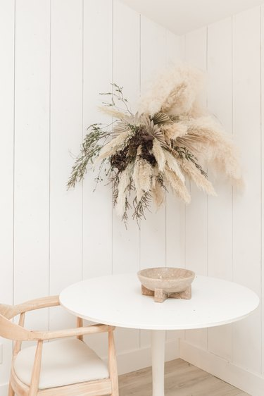 Fall floral arrangement hung over table