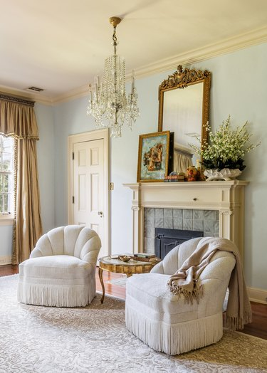 Traditional yet contemporary fireplace mantel by Thomas Guy Interiors