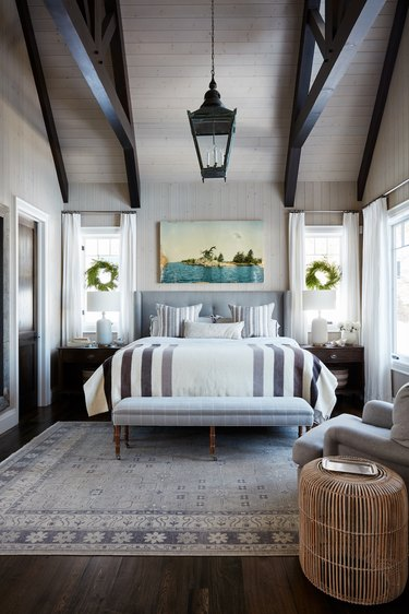 contemporary Christmas decor with wreaths hanging in contemporary bedroom with vaulted ceilings