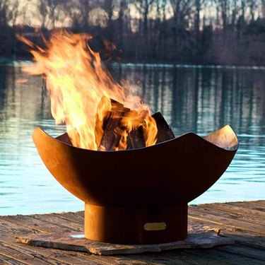 sculptural contemporary fire pit with rich iron patina