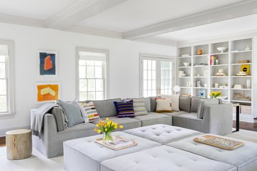secondary colors in neutral living room with sparse color accents
