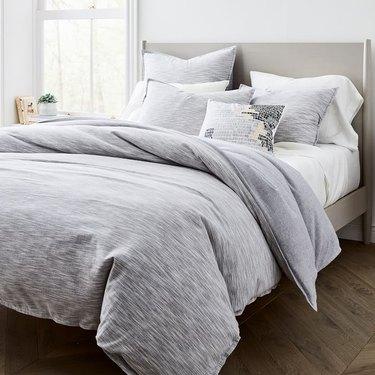 gray space dye duvet cover on bed