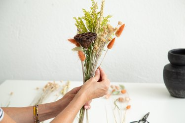 Arranging a dried floral arrangement