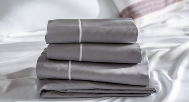 gray stacked linens with white stripe accent