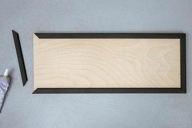 Gluing wood trim to wood board