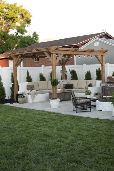 contemporary landscape in garden with pergola and seating