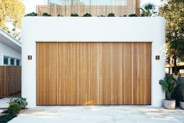 wood modern garage doors on white garage