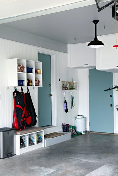 garage mudroom with overhead storage and concrete floors