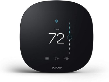 Rounded rectangular black smart thermostat